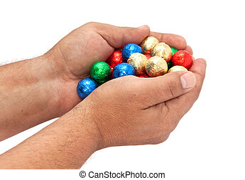 Shiny balls in the men's hands.
