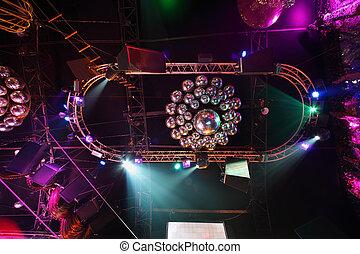 Shiny balls on ceiling, colorful lights in night club, black dynamics