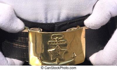 Shiny buckle marine belt. 4K. - Shiny buckle marine belt....