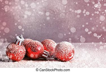 Shiny Christmas balls on snowy background.
