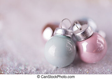 Shiny Christmas balls over snow background