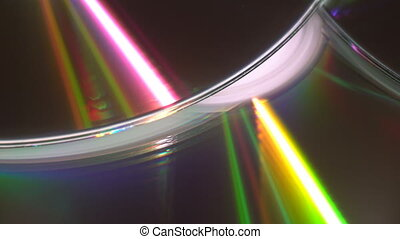 Shiny colorful reflection on CDs - A yellow glowing light ...