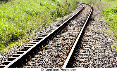 Shiny Curved Railway Track Running Through Countryside