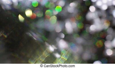 Shiny defocused crystal elements in the dark room.