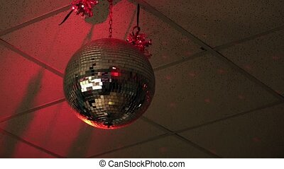 Shiny disco ball in empty nightclub