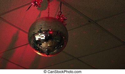 Shiny disco ball in empty nightclub