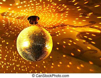 Shiny disco ball - Shiny golden disco ball on nightclub