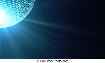 Shiny disco ball spinning around on smoke black background. Close up