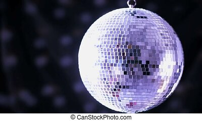 Shiny disco ball spinning around