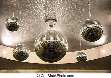 shiny disco balls on the ceiling in the hall