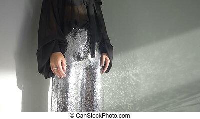 Shiny female pants - Horizontal crop shot of woman wearing...