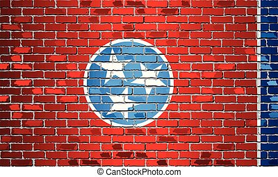 Shiny flag of Tennessee on a brick wall