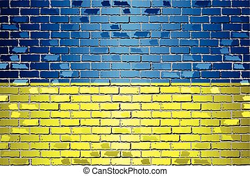Shiny flag of Ukraine on a brick wall