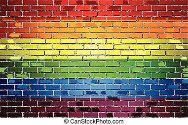 Shiny Gay pride flag on a brick wall