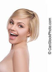 Shiny girl. Excited young blond hair woman looking at camera and smiling while isolated on white