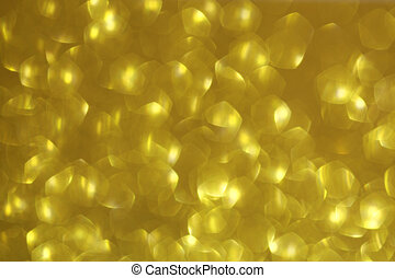 Shiny gold abstract background with a bokeh effect