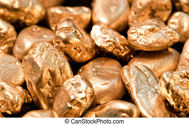 gold nuggets - shiny gold nuggets background. closeup.
