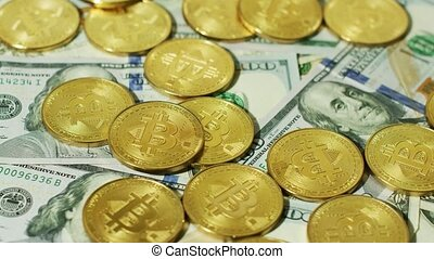 Shiny golden bitcoins with banknotes - Close-up view of...