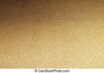 Shiny golden glitter texture background.