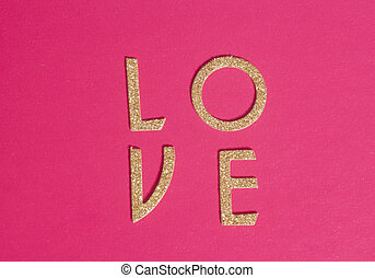 Shiny golden letters forming the word love