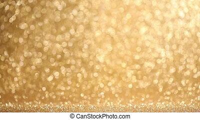 Shiny golden lights background - Shiny golden bokeh glitter...