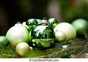 shiny green christmas baubles closeup macro and tree on ...
