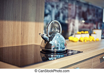 Shiny kettle - Shiny tea kettle on the kitchen table (...