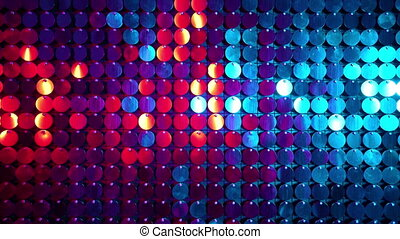 Shiny kinetic surface panel illuminated by pink and blue...