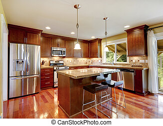 Bright shiny kitchen room with granite tops, tile back splash trim and steel stainless appliances