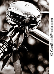 Shiny Metal Bicycle Bell - A monochrome closeup of the...
