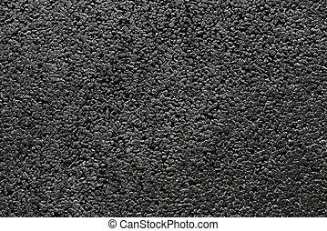 Shiny new black asphalt abstract texture background.