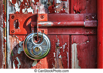 Shiny new padlock on an old door.jpg