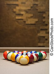 shiny pool balls arranged on table