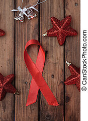 Shiny red satin ribbon on a Christmas table, a symbol of the...