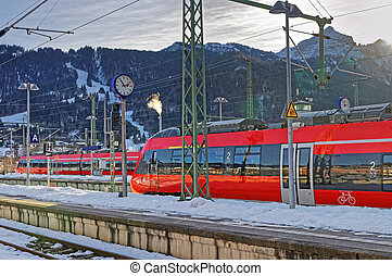Shiny red train stopped at the Garmisch-Partenkirchen railway station