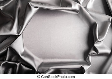 Shiny silver satin curved in various lines.