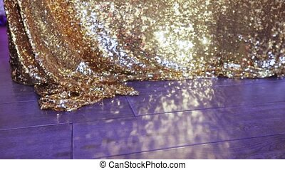 Shiny tablecloth and glare - Glare on the floor from a...