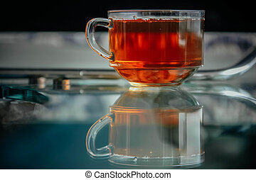 Shiny transparent glass cup with tea.