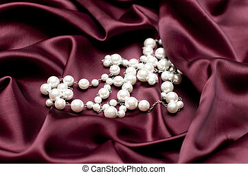 pearls on ruby satin