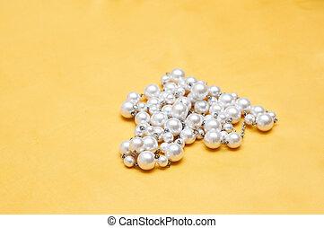 pearls on yellow satin