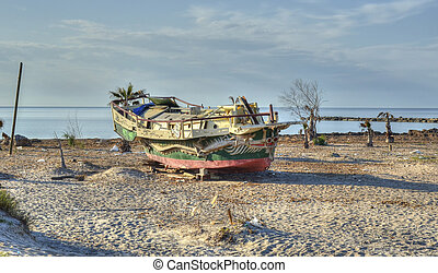 Ship aground and abandoned