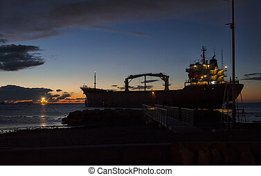 Ship aground off the coast - View of ship aground off the...