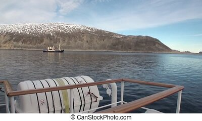 Ship and water surface view from boat in Arctic Ocean...