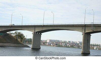 ship bridge sails under the bridge on the bridge going car...