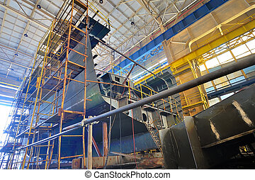 Ship building shoot inside of shipyard