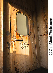 Old ship deck canin door entrance decor of era in ocean transport