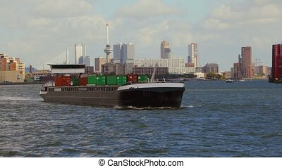 Ship carrying containers through rotterdam - Ship...