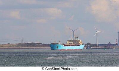 Ship carryingcargo through rotterdam - Cargo ship in heat...