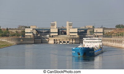 Ship comes out of the gateway of the reservoir, Volgograd, Russia