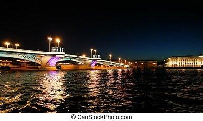 Ship departures from Blagoveshchensky Bridge across night...